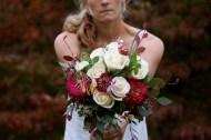 Megan holding the bridal bouquet.