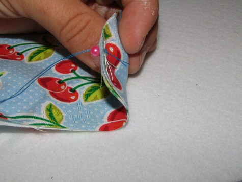 My knotted end of thread on the back side of the squares I am working.