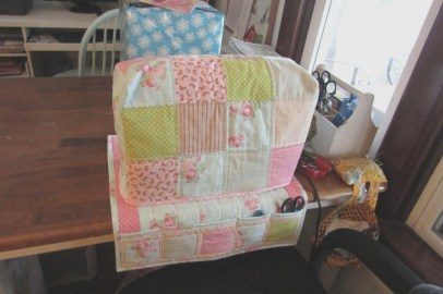 A new, easy to use cover for my sewing machine helps to deter little hands from playing with the dials and buttons.