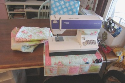 She also made a pincushion for strapping onto the machine and this mat to go under my machine. It has little pockets for storing my snips and seam ripper.