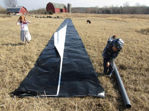 The tarp rolled out, waiting to be unfolded.