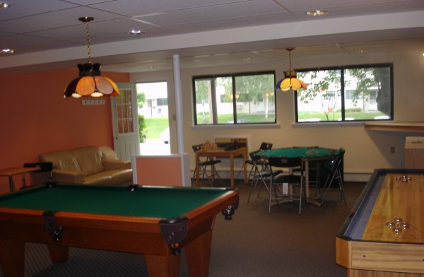 Clubhouse with pool table, card table and table shuffle board.