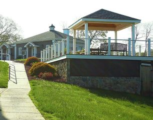 Path looking at Springvale Main Office with pavilion on the right.
