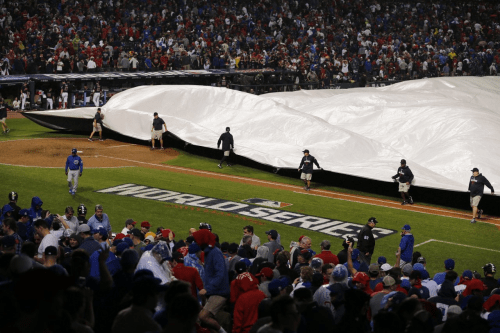 Ground Crew Covers The Field