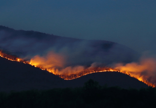 The Rocky Mount fire burns in Shenandoah National Park, seen from McGaheysville, Va., on the night of April 19. (Larry W. Brown)