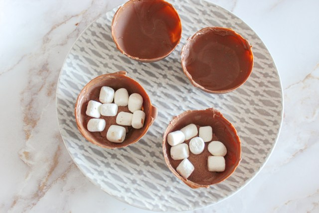 open hot chocolate bomb filled with mini marshmallows and hot chocolate mix