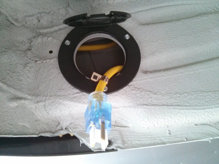 Under the van, there are large holes in the rocker panel. Perfect for a cable with a hinged cover.