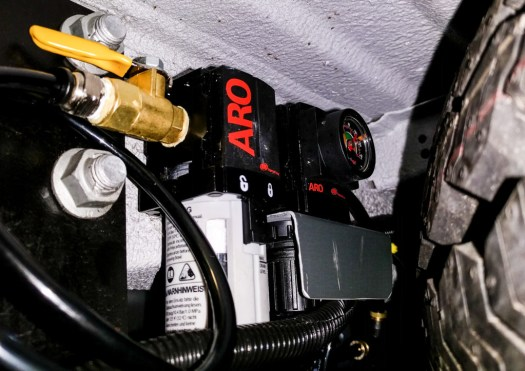 Air filter and pressure reducer next to spare tire