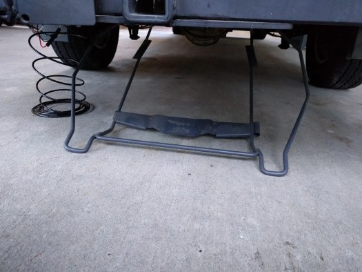 The spare tire holder lowered to the ground