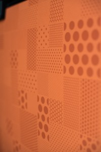 Tangelo Halftone formica accent panel on the fridge