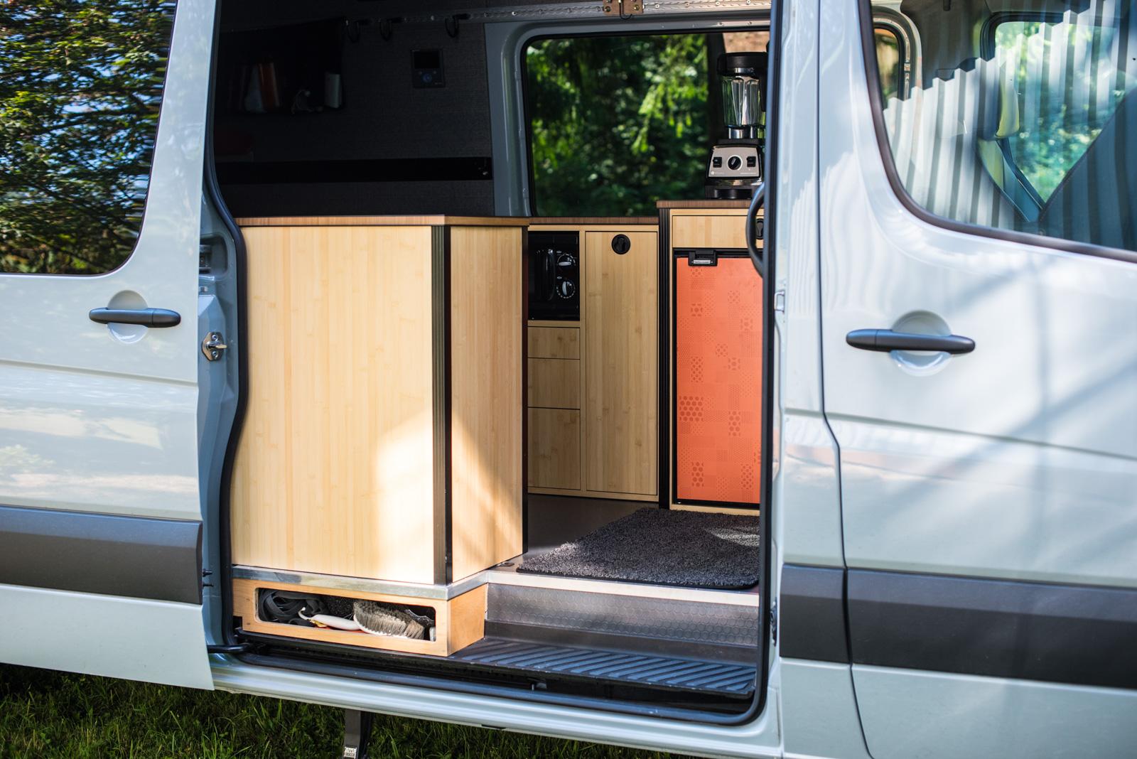 View of cabinets through open sliding door