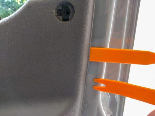 Door panel removal - lever the plastic panel away from the metal door