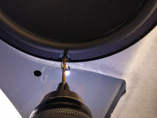 Mount the speaker in place, then carefully drill holes in the spacer and attach the speaker screws