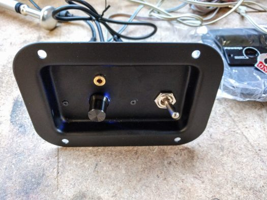 The front of the plate with the components mounted to it.