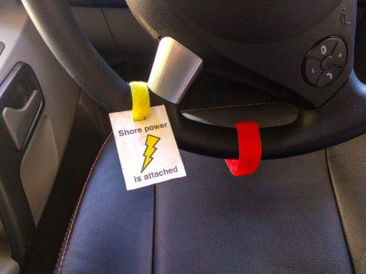 Velcro cable ties as reminders on steering wheel