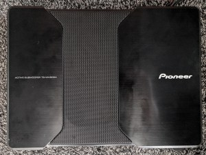 The Pioneer subwoofer we installed behind the driver's seat, hooked up to the output from the center channel speaker