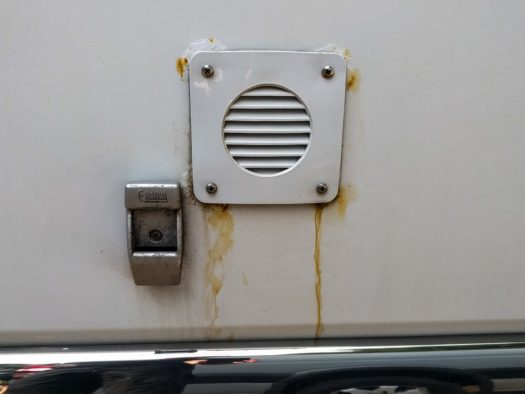 Notice the rust bubbles where the screws enter the van metal. The stainless screws haven't rusted, but the sheet metal they are attached to has.