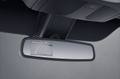 There's an option that places the backup camera display in the rear view mirror
