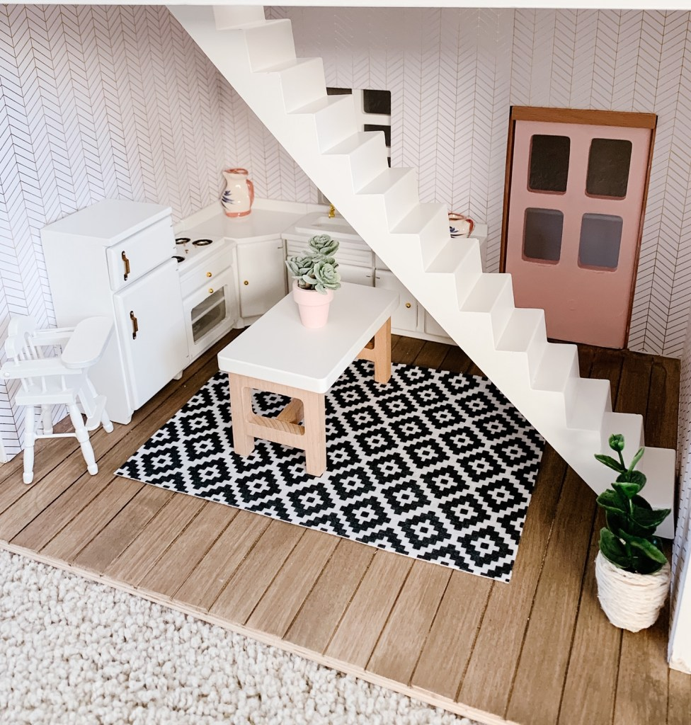 target hearth and hand dollhouse kitchen with white cabinets, wood floor and aztec rug and faux plants