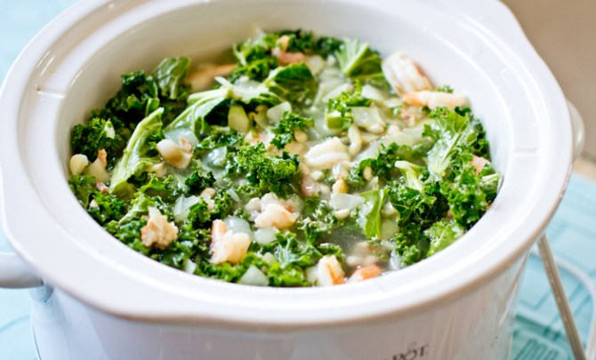 Healthy slow cooker recipe made with shrimp, kale and white beans.