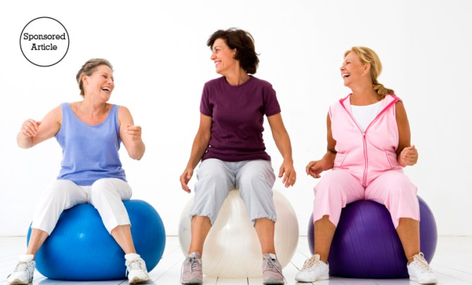 Women workout on exercise balls.