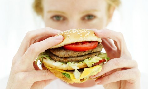 Woman-Holding-Hamburger-Fast-Food-Unhealthy-Spry-475x285