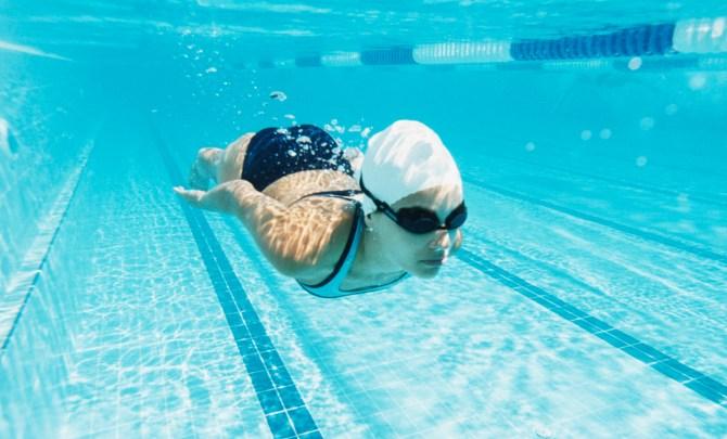Woman swimming in pool.