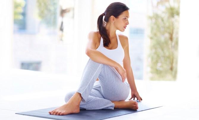 Woman sitting in twist pose.