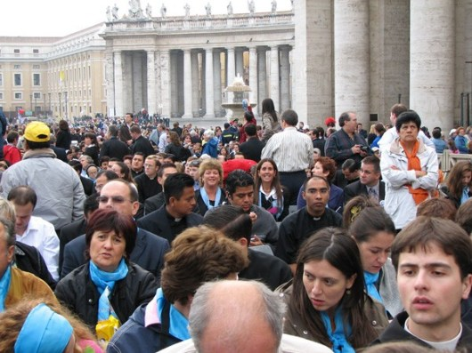St. Peter's Square was filled with people sitting and standing shoulder-to-shoulder.