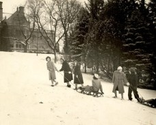 Students pull sleds up a hill at Ladywood School, Indianapolis, in 1941.