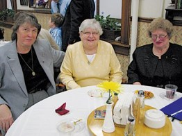 Lynn Reese, Sister Mary Ann Phelan and Mary Loretta Reese (left to right) enjoy one another during the reception. Sister Mary Ann served as the companion to Lynn and Mary Loretta, both of whom are from Greenfield, Ind.
