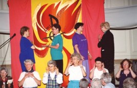 Sisters and facilitators of the General Chapter 2001 perform a skit during a dinner in O'Shaughnessy Dining Room.