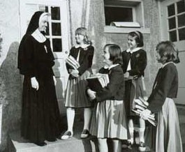 Students at Dunblane School in Washington, D.C., in the 1960s greet their teacher, Sister Eileen Ann Kelley, at the start of another day.