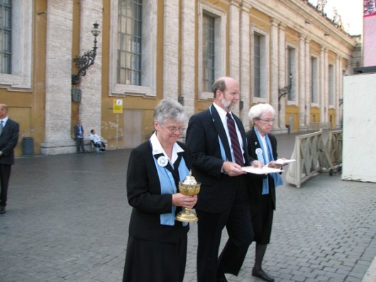 General Superior Sister Denise Wilkinson, Phil McCord, and Sister Marie Kevin Tighe carry the gifts in the offertory procession.