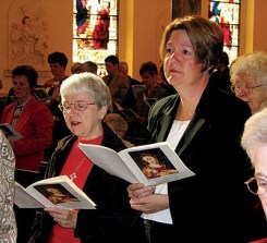 Alice Shelton (right) and her companion Sister Margaret Quinlan participate in the Rite of Commitment.