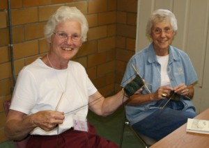 Sisters Jean Fuqua, left, and Jeanne Knoerle participate in knitting socks at Fiber Frolic 2006.
