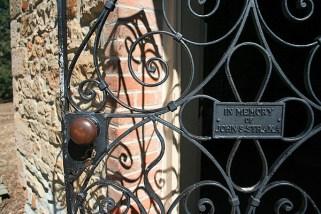 The door is intricate metal scrollwork.