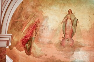 This painting is in the semi-dome of the church.