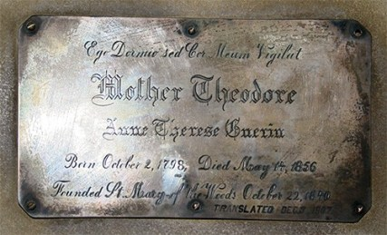 This plaque used to mark the tomb of Saint Mother Theodore Guerin. (She has since been moved up to the main Church.)