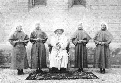 The development of a native sisterhood was one of the greatest accomplishments for the Chinese mission in the 1930s. Pictured with the Rev. J.N. Tacconi are four Providence Sister-Catechists after investiture ceremonies.