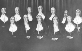 Ten of these SPs were interned in the concentration camp during World War II. Though not interned, the two native Chinese Sisters of Providence, Sisters Agnes Joan Li and Bernadette Ma, faced the challenge of carrying on the work of the SP mission in China. Seated from left: Sisters Agnes Loyola Wolf, Marie Patricia Shortall, Marie Gratia Luking, Monica Marie Rigoni and Saint Francis Schultz; standing: Sisters Agnes Joan Li, Mary Liguori Hartigan, Carmel Baker, Theodata Haggerty, Francis De Sales Russell, Mary Margaretta Grussinger and Bernadette Ma.