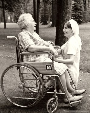[between 1971-1976] Infirmary patient Sister Bernadette Therese Whelan enjoys a fall outing with nurse Sister Mary Jo Piccione.
