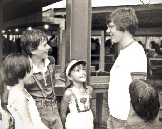 Sister Betty Paul enjoys a break with youngsters at a Youth Summer Camp in 1978.