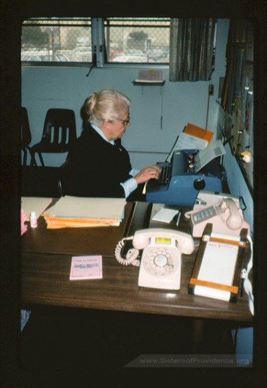 Sister Edith Pfau, secretary at St. Anthony School in Gardena, CA, circa 1986. In addition to decades of ministry in art education, Pfau was herself an accomplished painter and artist.