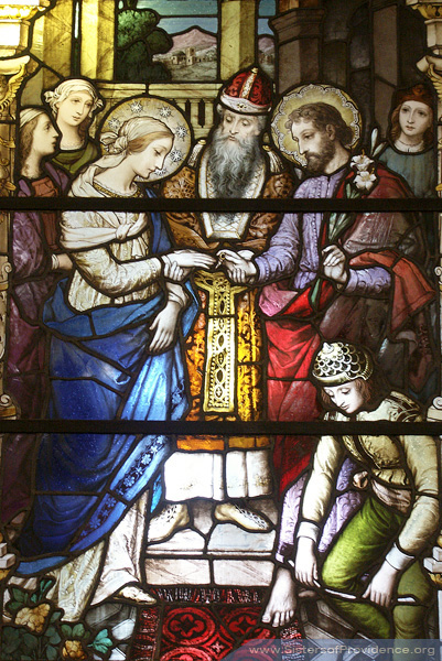 The Church of the Immaculate Conception is on the motherhouse grounds of the Sisters of Providence of Saint Mary-of-the-Woods, Indiana. Its beautiful windows were made by the Bavarian Art Institute of Munich, Germany. This window tells the story of the marriage of Mary and Joseph.