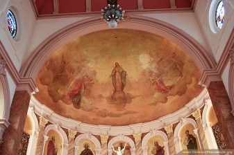 This painting in the semi-dome of the Church of the Immaculate Conception was done by Tadeusz Żukotyński (or Thaddeus von Zukotynski). It is a fresco that took Żukotyński three months to complete. It represents the Immaculate Conception of the Blessed Virgin Mary. She stands on a globe supported by clouds with Saint Michael and Saint Gabriel on either side.