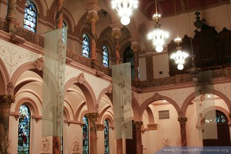 The interior of the church utilizes soft rose colors. The Church of the Immaculate Conception is on the motherhouse grounds of the Sisters of Providence of Saint Mary-of-the-Woods, Indiana.