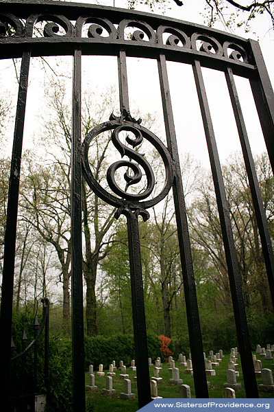 "The gate to the Sisters of Providence Convent Cemetery in Saint Mary-of-the-Woods, Indiana. The ""S"" is for Sisters; the other gate door has a ""P"" for Providence. This cemetery is one of the resting places of Saint Mother Theodore Guerin, the Congregation's foundress."