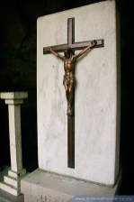 A simple metal crucifix sits atop the altar.