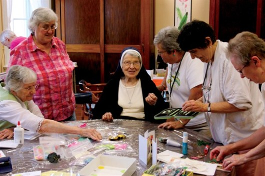 Sister Rosalie Marie Weller (center) gets a spot at a table to start creating a card on July 17, 2012. To her right is Sheila Donis, PA, and Sister Marilyn Therese Lipps. To her left is Virginia Cook, activity assistant, and Sisters Mary Lou Ruck and Donna Butler.